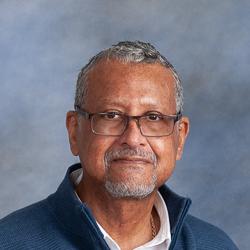 Portrait of man wearing blue sweater