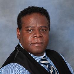 Portrait of male wearing vest.