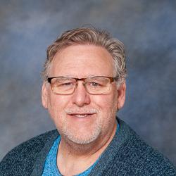 Portrait of a man wearing sweater.