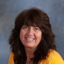 Portrait of woman in yellow