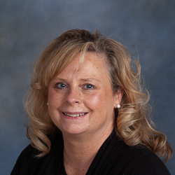 Portrait of blond woman wearing black